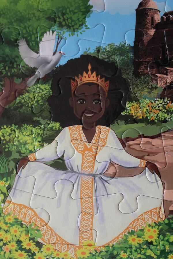 Das Puzzle entstand durch eine äthiopische Kinderbuchautorin, so gibt es ein äthiopisches Mädchen in traditionellem Kleid.